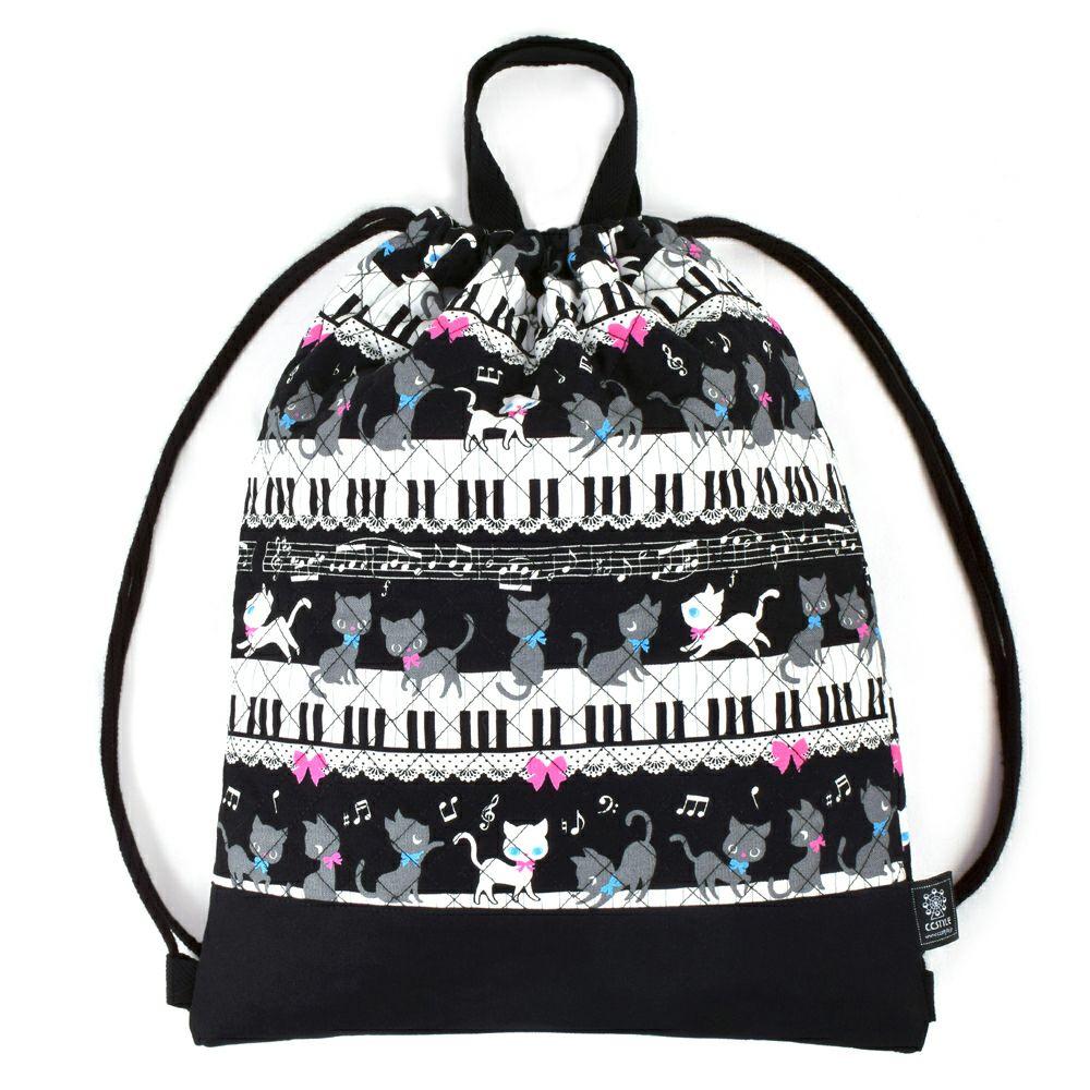 ナップサック キルティング ピアノの上で踊る黒猫ワルツ(ブラック)_1